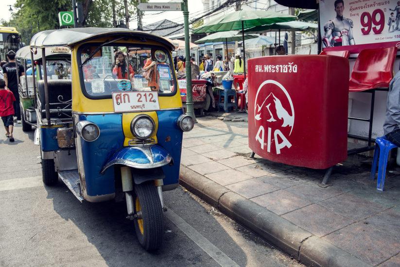 Traditional Bangkok tuk tuk parked at the side of the road